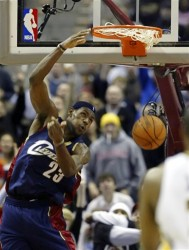LeBron James dunks against the Indians Pacers during the third quarter of the Cavaliers' 94-89 NBA basketball win Friday, Dec. 23, 2005, in Cleveland.